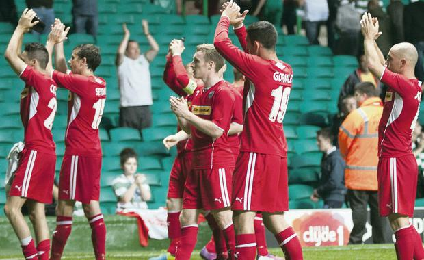 Cliftonville players applaud their travelling fans after Tuesday's Champions League match at Parkhead
