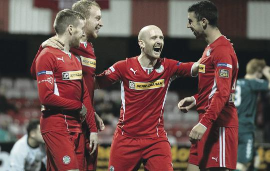 All smiles: Joe Gormley is congratulated by his Cliftonville team-mates Chris Curran, Liam Boyce and Ryan Catney after scoring his third goal of the evening