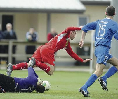 Red mist: Alvin Rouse was given his marching orders after this challenge on Cliftonville striker Joe Gormley