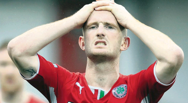 Frustration: Cliftonville midfielder Ryan Catney's assertive display was undermined when his backpass allowed Warrenpoint to find the net at Solitude