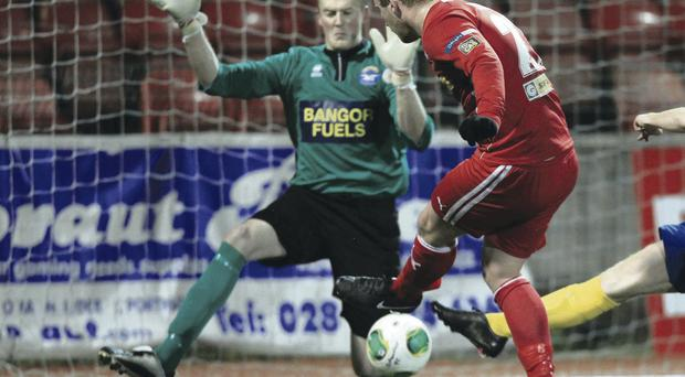 Get in: Liam Boyce fires Cliftonville's second goal past Paul Cairnduff