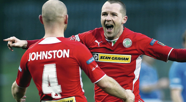 Marc Smyth celebrates with Barry Johnston after putting Cliftonville in front