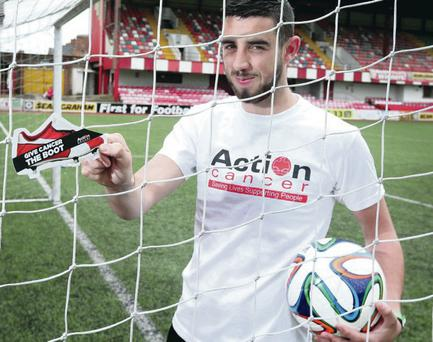 Sign up: Cliftonville's Joe Gormley helps Action Cancer launch their Charity Football Challenge, asking local clubs to raise funds and awareness of male specific cancers for the charity's 'Action Man' campaign by organising their own 6-a-side tournaments