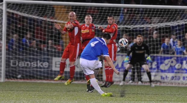 So close: Linfield's Chris Hegarty almost scores with a dipping freekick against Cliftonville at Solitude last night
