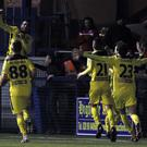Jumping Joe: Cliftonville striker Joe Gormley celebrates after netting the extra-time winner against Ards