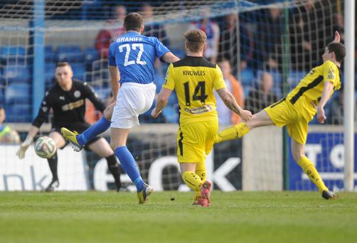 Back of the net: Glenavon's Kevin Braniff fires home his second goal in yesterday's demolition of Cliftonville