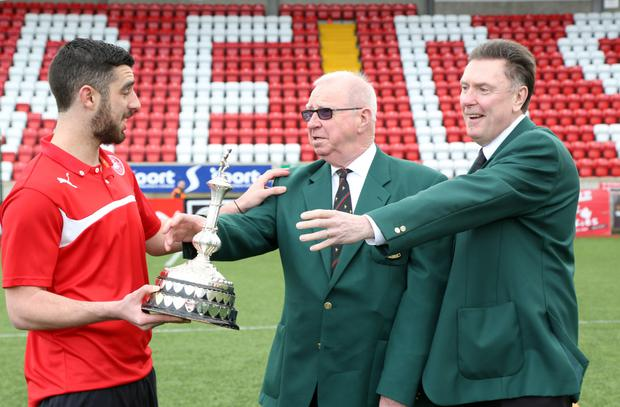 Star man: Cliftonville's Joe Gormley may reluctantly have to hand back his Ulster Player of the Year trophy to Cecil McKeag and Robert Keenan, representatives of Castlereagh Glentoran Supporters' Club