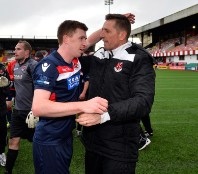 Job well done: Billy Joe Burns embraces manager Stephen Baxter after Crusaders' victory at Solitude all but clinched the Gibson Cup