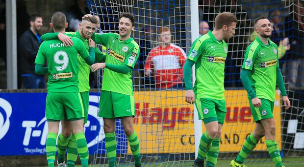 Three'n'easy: Rory Donnelly is congratulated after scoring