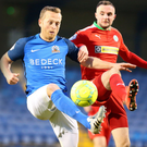 Old warrior: Sammy Clingan holds off Cliftonville's Jude Winchester