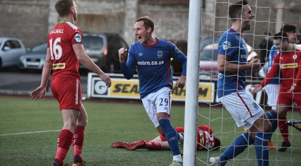 Helping hand: Achille Campion and Andy Waterworth react with delight after Tomas Cosgrove's own goal had made it 2-0