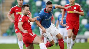 Fitness race: Linfield ace Andy Waterworth, who is struggling with a back injury, tussles with Cliftonville's Jamie Harney
