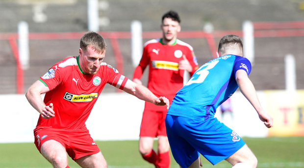 Hard fight: Chris Curran takes on Loughgall's Jamie Rea