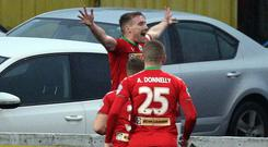 Get in: Chris Curran celebrates his sweet strike against Swifts