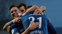 Seizing the day: Linfield celebrate Niall Quinn's goal at Solitude on Saturday
