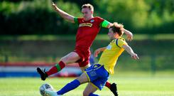 Full stretch: Cliftonville ace Chris Curran battles for possession with Chris Hugh of Barry Town