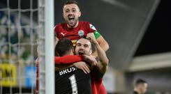 Spot on: Cliftonville players hail their penalty shoot-out hero, Richard Brush