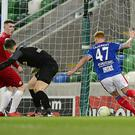Decisive strike: Chris Casement scores for Linfield to send David Healy's side top