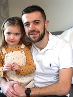 Daddy's girl: Conor McMenamin with three-year-old daughter Daisy