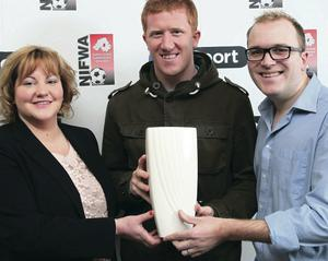 Eugene Ferry receives his award from Marie McMullan of BT Sport and Paul Ferguson, Sunday Life sports editor