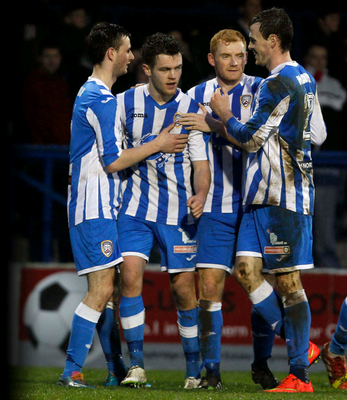 On course: Shane McGinty (second from left) is lauded after making the breakthrough against Cliftonville