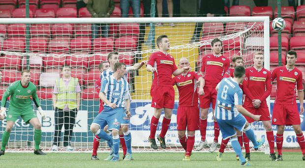 Inch perfect: Neil McCafferty strokes home a free-kick for Coleraine's first goal