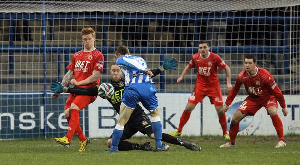 Big fright: Portadown's Billy Brennan stands in the way of Coleraine's Ian Parkhill at the Showgrounds yesterday