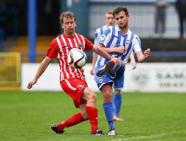 My ball: Coleraine's Adam Mullan makes a clearance