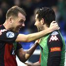 Head boy: Ciaran Caldwell celebrates with Curtis Allen after the Glentoran striker had headed his team into a 2-0 lead against Coleraine