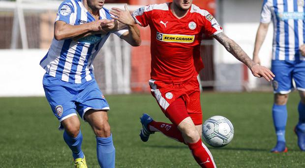 Forward motion: Cliftonville's Jude Winchester takes on Neil McCafferty