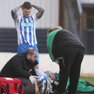 Jordan Allan shows his concern as Eoin Bradley receives treatment