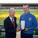 Recognition: Oran Kearney collects his award from NI Football Writers chairman Stephen Watson
