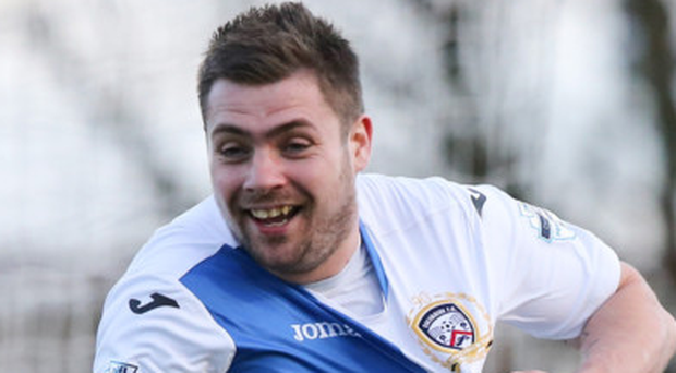 Delight: James McLaughlin wheels away after his last-gasp heroics