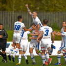 Leading the way: David Ogily laps up the adulation after firing Coleraine in front at Solitude
