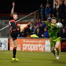 Duel: Coleraine keeper Chris Johns will come up against Crusaders' in-form winger Gavin Whyte once again tomorrow