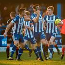On target: Jamie McGonigle (right) is congratulated after his second goal of the game sparked Coleraine's comeback