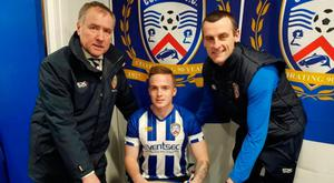Fresh face: Aaron Burns is welcomed to Coleraine by chairman Colin McKendry (left) and manager Oran Kearney