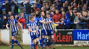 Jamie McGonigle is congratulated after his late winner against Cliftonville