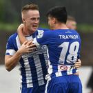 Immediate impact: Aaron Burns celebrates his deadly double with Coleraine team-mate Aaron Traynor