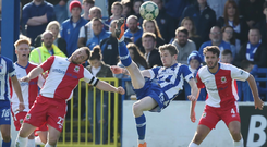 Acrobatic effort: Coleraine's Jamie McGonigle tries his luck