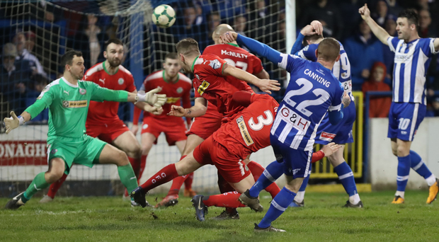 Defensive mayhem: Arron Canning fires in Coleraine's third goal