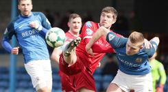 Tussle: Steven Douglas battles with Glenavon's Andy Mitchell