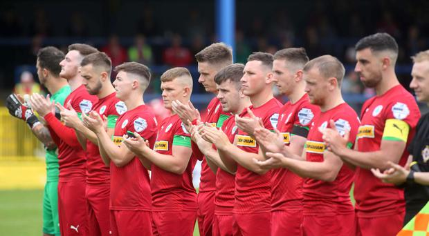 Reds fans and players play tribute to their late former manager Tommy Breslin