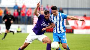 Shove match: Larne's Johnny McMurray with Aaron Traynor