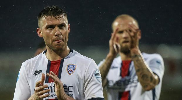 Clap of honour: Stephen Lowry applauds the Coleraine fans after helping his side stay top of the table