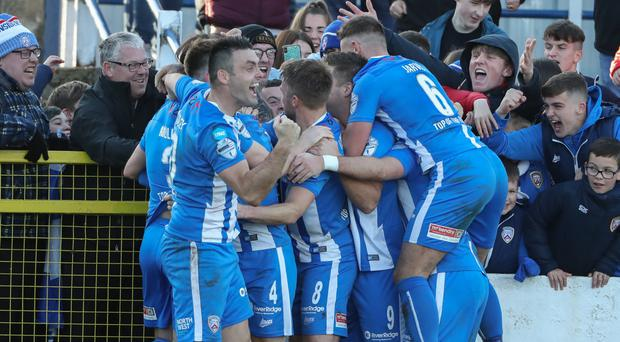 Decisive moment: Coleraine players celebrate their late breakthrough at The Showgrounds