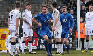 Head boy: Dougie Wilson beams with delight after putting Dungannon in front