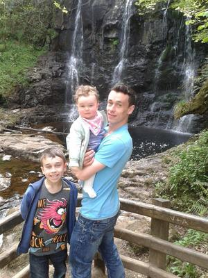 Paul Heatley with his kids at Glenoe waterfall