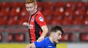 Crusaders' Jarlath O'Rourke in action with Dungannon's Caolin Coyle