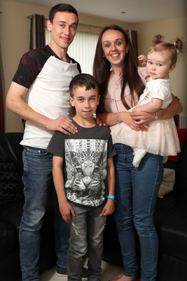 Family man: Paul Heatley at home with his wife Laura, son Cailan and daughter Eva